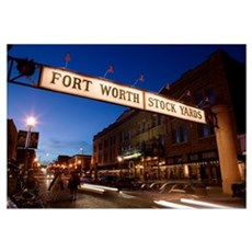 Signboard over a road at dusk, Fort Worth Stockyar Framed Print